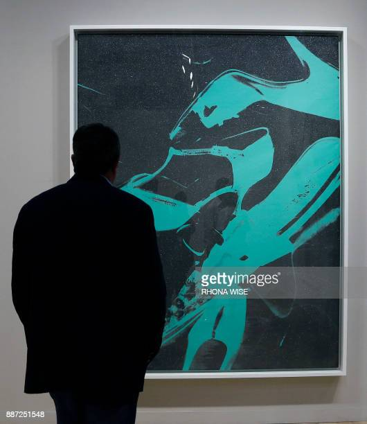 An Art Basel patron views Diamond Dust Shoes' by American artist Andy Warhol during the Art Basel Miami in Miami Florida December 6 2017 Art Basel...