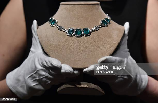 An art deco emerald and diamond necklace by Chaumet expected to realise 120000 180000 GBP at auction is seen during a photocall at Christie's auction...