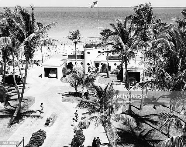 An Art Deco parks department building stands next to a public beach Miami Beach Florida late 1940s