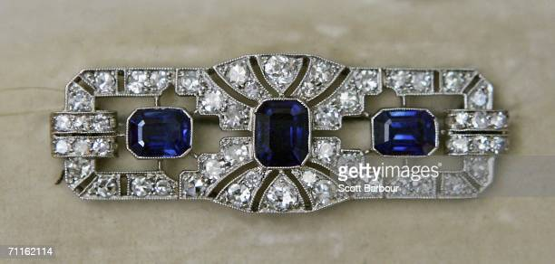 An Art deco Sapphire and Diamond Broach sits on display during a photocall of jewellery and works of art from the Collection of Her Royal Highness...