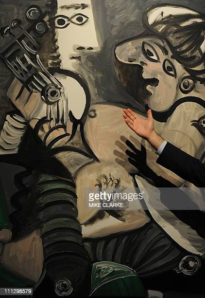 An art expert explains a painting by Picasso entitled Couple a la Guitare estimated at 10 15 million USD at a Sotheby's auction preview in Hong Kong...