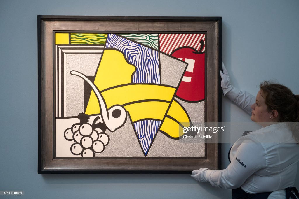 An art handler adjusts 'Cubist still life' by Roy Lichtenstein (estimated at £1.8 million to £2.5 million) during a preview of the Contemporary Art sale at Sotheby's on June 14, 2018 in London, England. The sale will take place on 26 June 2018 and includes works by artists Hockney, Freud and Basquiat.