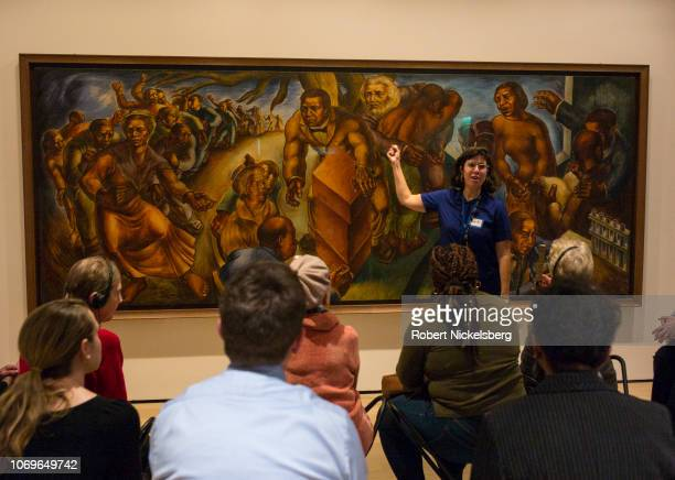 An art history guide right describes the 1939 mural by Charles White titled 'Five Great American Negroes' at the Museum of Modern Art New York City...