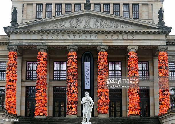 An art installation by Chinese artist Ai Weiwei showcases thousands of used life vests by refugees from the Greek island of Lesbos on February 14...
