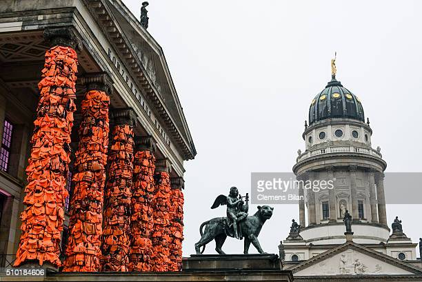 An art installation by Chinese artist Ai Weiwei that consists of life vests worn by refugees bound to the columns of the concert house next to a...
