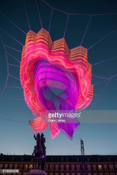 An art installation featuring a net sculpture of layers of fibre braided and knotted together that is paired with spectacular lighting it keeps...