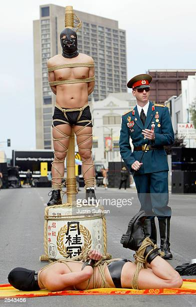 An art installation including two men tied up is displayed at the 20th Annual Folsom Street Fair September 28 2003 in San Francisco California The...