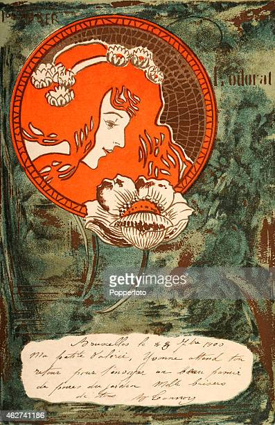 An art nouveau postcard illustration featuring a mosaic roundel of a longhaired young woman superimposed on a moody water feature circa 1900
