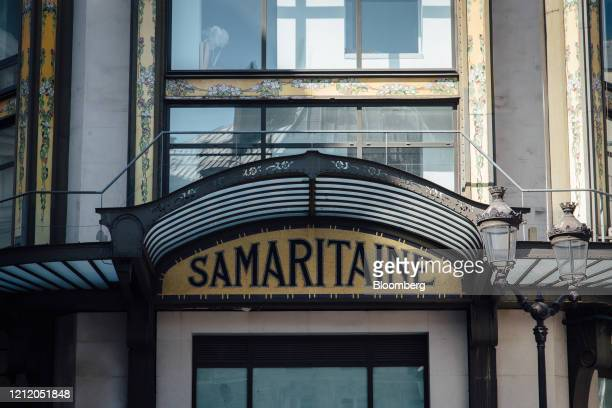 An art nouveau sign sits above an entrance of the Samaritaine luxury department store building operated by LVMH Moet Hennessy Louis Vuitton during...