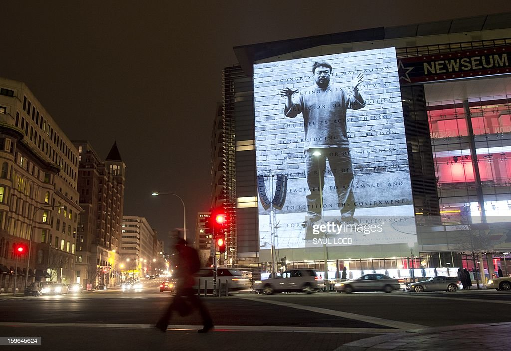 An art projection by Chinese artist and activist Ai Weiwei appears on the 74-foot marble First Amendment tablet on the exterior of the Newseum in Washington, DC, on January 17, 2013. Ai is recognized as an advocate of universal human rights and an outspoken critic of the Chinese government's stance on democracy. AFP PHOTO / Saul LOEB