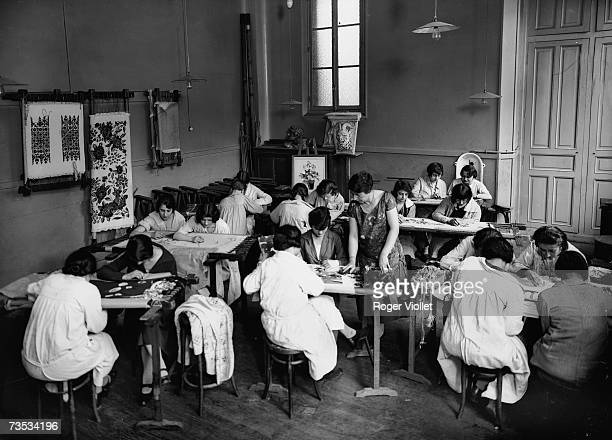 An Art school in Paris about 1925 having an embroidery lesson in Paris France