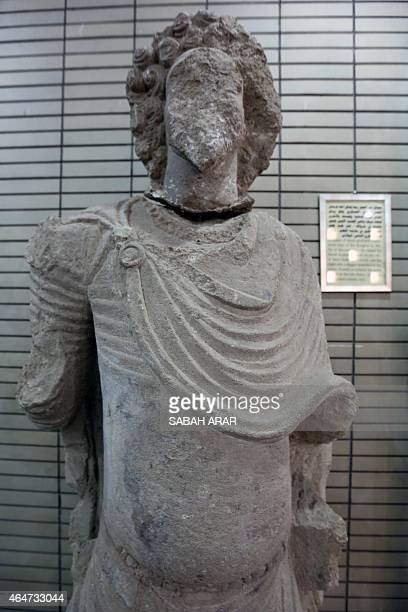 An artefact coming from the area of Mosul and dating back to the second century BC is displayed during the official reopening of Iraq's national...
