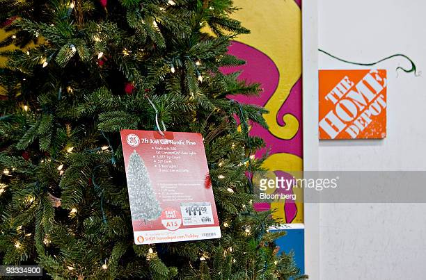an artificial christmas tree sits on display inside a home depot store in new york us - Home Depot Christmas Tree