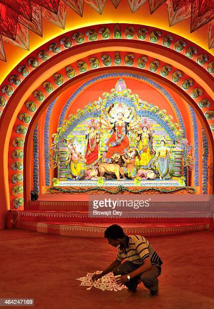 An artisan engaged in decorative work at Puja Pandal in Kolkata. In Hinduism, Mother Durga represents the embodiment of shakti, the divine feminine...