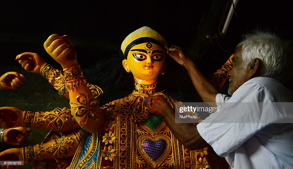 An Artisan giving the final touch to the idol of Hindu goddess Durga for the upcoming Durga Puja festival in Kolkata India on Monday 26th September...