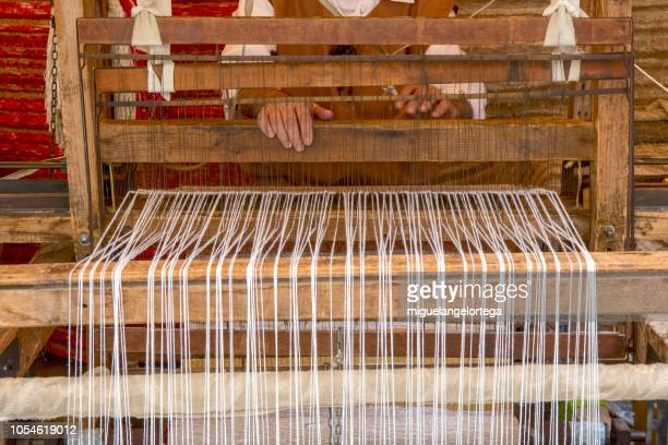 an artisan loom in a market street - loom stock pictures, royalty-free photos & images