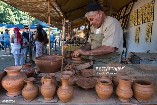 An artisan makes clay pottery during the 21st edition of the Medieval Journey dedicated to the kingdom of Afonso IV the Brave King of Portugal and...