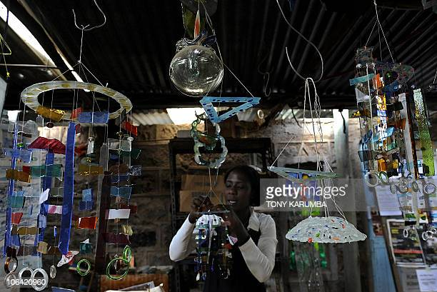 An artisan makes stainedglass chimes on October 8 2010 at the Kitengela glassworks some 30 kms southwest of Nairobi owned and run by Nani Croze a...