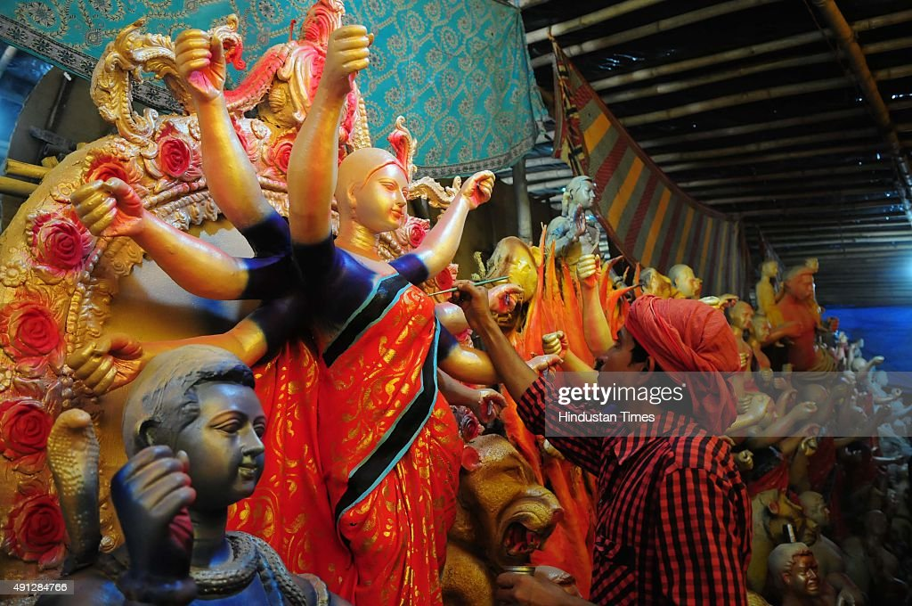 An artisan making idol of Goddess Durga for the Durga Puja celebrations on October 4 2015 in Bhopal India Durga Puja festival marks the victory of...