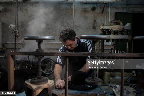 An artisan works in the Vimercati Hats' workshop on March 1 2017 in Monza Italy Vimercati Hats is the last familyrun company producing handmade...