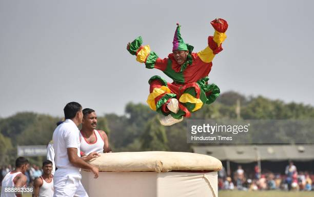 An artist as clown during the celebration of 257th Corps Day of Army Service Corps at Agram ground on December 9 2017 in Bengaluru India Motorcycle...