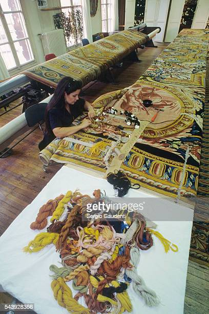 An artist at work in a workshop for tapestrymaking
