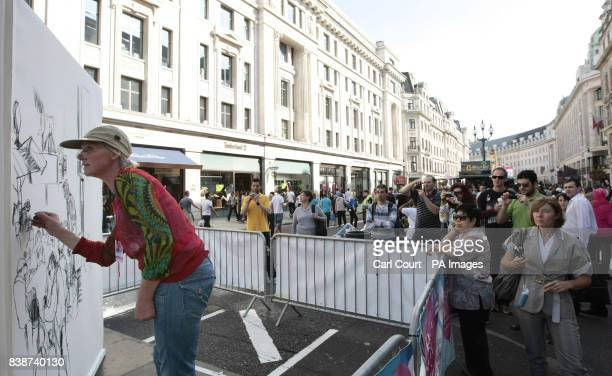 An artist creates a giant art installation birthday card at the Regent Street Festival 2009 London The festival celebrates it's 10th year and...