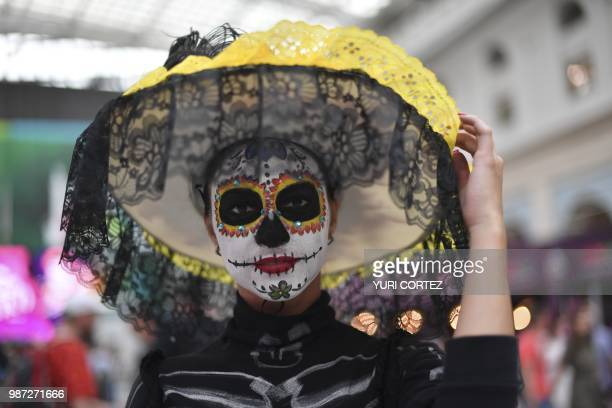 An artist disguised as Catrina performs in Moscow on June 29 2018 during a Mexico's Day of the Death celebration in the frameworks of Russia 2018...