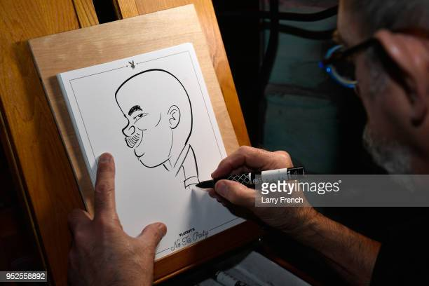 An artist draws caricatures during Playboy Presents No Tie Party at The Living Room on April 28 2018 in Washington DC