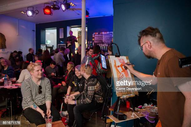 An artist draws portraits of the audience in the Black Box at Culture Night Belfast on September 22 2017 in Belfast Northern Ireland