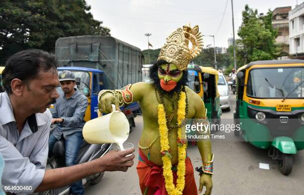 An artist dressed like the character of Ramayana distributing drinks during a road show on the occasion of 9th day of Navratri at a Hanuman Temple...