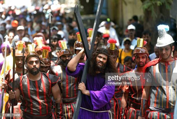 An Artist enacts the crucifixion of Jesus on the accession of Good Friday on behalf of Scared Hearted Church at Santacruz, on April 19, 2019 in...
