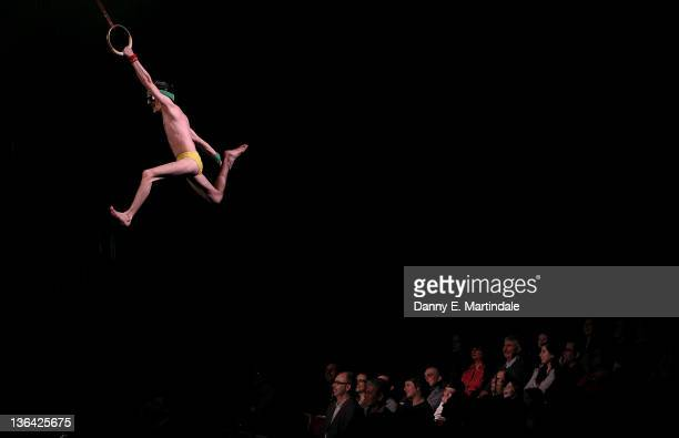 An artist from Cirque du Soleil Totem performs at Royal Albert Hall on January 4 2012 in London England