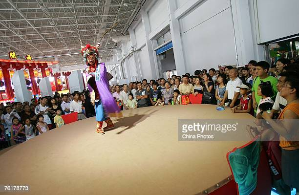 An artist from the Inner Mongolia Region perform the Mongolian opera Erdos Wedding at the 2007 West China Culture Industry Expo on August 19 2007 in...