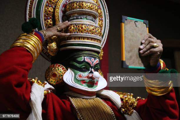 An artist from the Kathakali School Society of Thrissur prepares backstage for his performance in a programme organised by Madhya Pradesh Tribal...