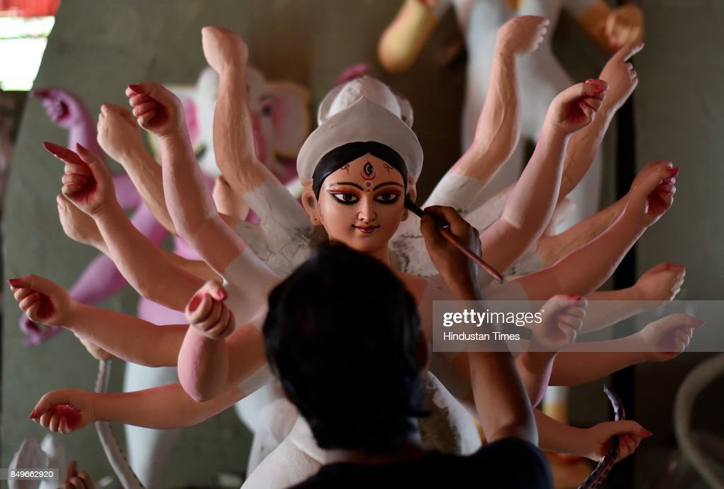 An artist gives final touch to an idol of Goddess Durga for the upcoming Durga Puja at Kali Bari on September 19 2017 in New Delhi India