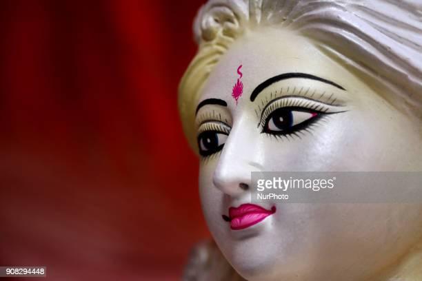 An artist giving his final touch to an idol of Devi Saraswati at Jagannath Hall of Dhaka University Bangladesh on 21 January 2018