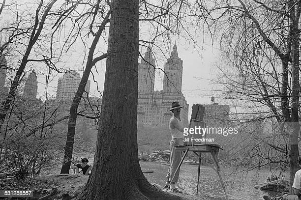 An artist in Central Park New York City with the San Remo in the background circa 1976
