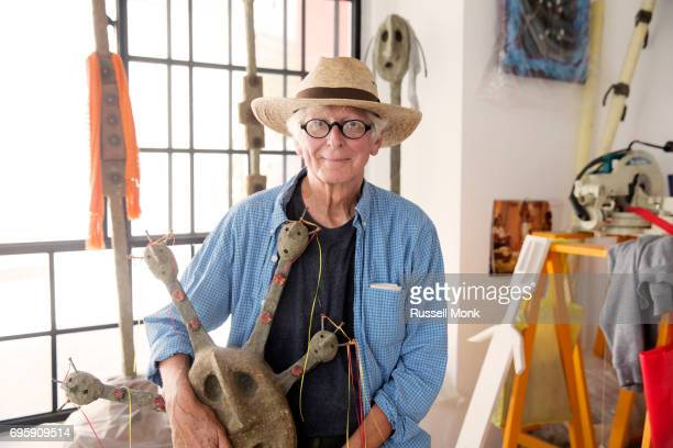 an artist in his studio - straw hat stock pictures, royalty-free photos & images