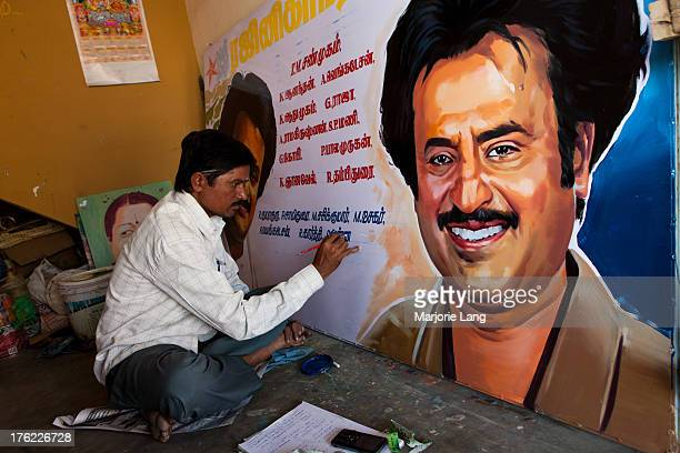 An artist is painting a poster with the famous Kollywood actor Rajinikanth, for celebrating his birthday. Tiruvannamalai, Tamil Nadu, India.