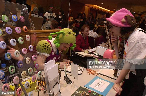 An artist makes a drawing of a manga character for a customer at the 11th annual Katsucon one of 70 conference devoted to mangas anime and video...