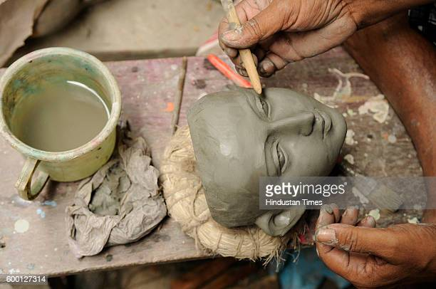 An artist making an idol of Goddess Durga for the big festival 'Durga Puja' at West Bengal Kumortolli a hub of clay Idol on September 7 2016 in...