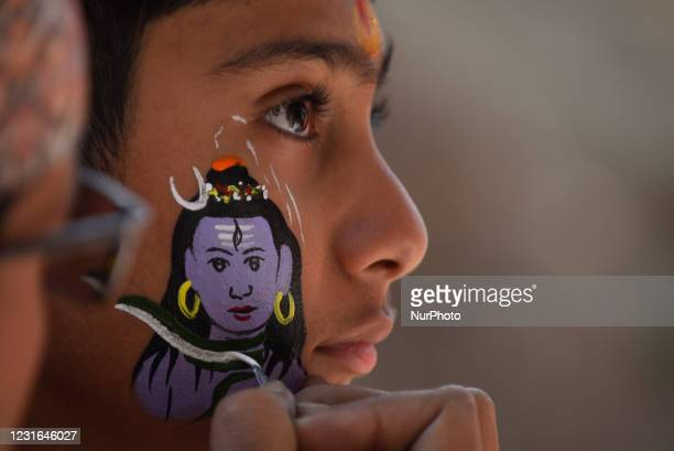 An artist making face paint of lord Shiva in face of young boy during Maha Shivaratri at Kathmandu, Nepal on Thursday, March 11, 2021. Less number of...