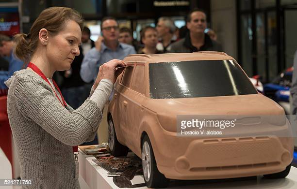 An artist models a car in clay at MP Artware stand in Euromold 2014 Frankfurt Germany 27 November 2014 EuroMold is the world trade fair for...