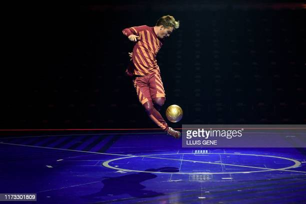 An artist of the Canadian entertainment company Cirque du Soleil performs during a rehearsal of the Messi10 show based on the career of Argentinian...