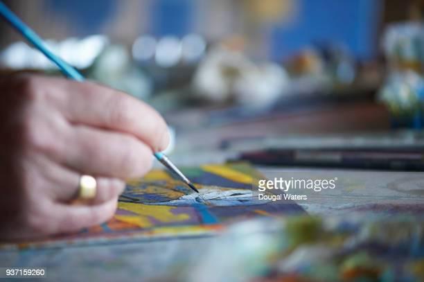 An artist painting close up.