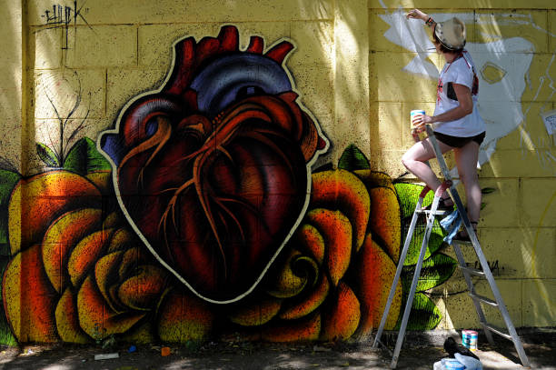 an artist paints a graffiti in a neighbo pictures getty images