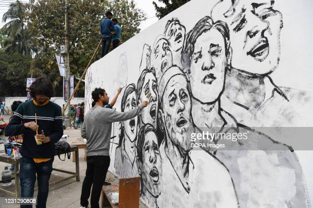 An artist paints a mural at the Central Shaheed Minar ahead of the International Mother Language Day. Bangladesh is preparing to celebrate the...