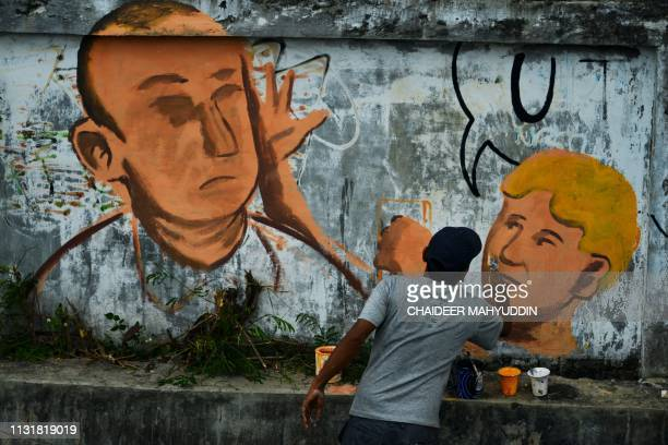 An Artist paints a mural depicting Australian senator Fraser Anning being hit in the head with an egg by William Conolly in Banda Aceh Aceh province...
