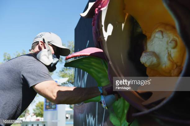 An artist paints during day 1 of Grandoozy on September 14 2018 in Denver Colorado